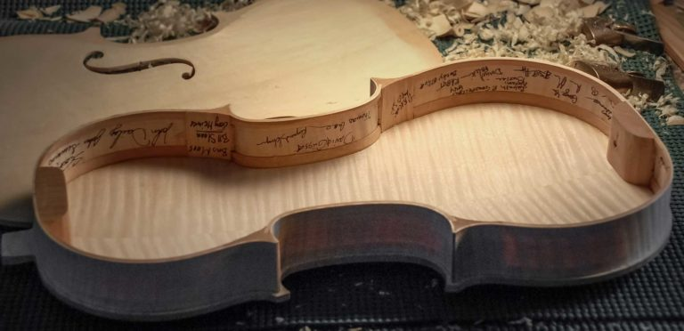 Group Violin with signatures at the Oberlin Violin Makers Worhshop